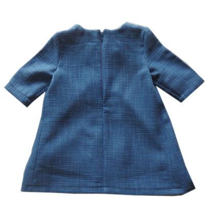Blauw Birdie jurk met springplooi achterkant
